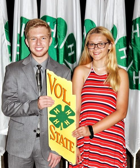 Two 4H Students holding a 4H Vol State banner